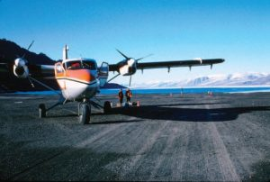 Figure 2. Our Twin Otter aircraft at Frigg Fjord, or 'Drivhuset' (the 'hot-house'), showing the open water where Fränkl and Müller had landed by Norseman fl oatplane in 1953 to cross Peary Land for the fi rst time. The picture was taken at 5 minutes after midnight.